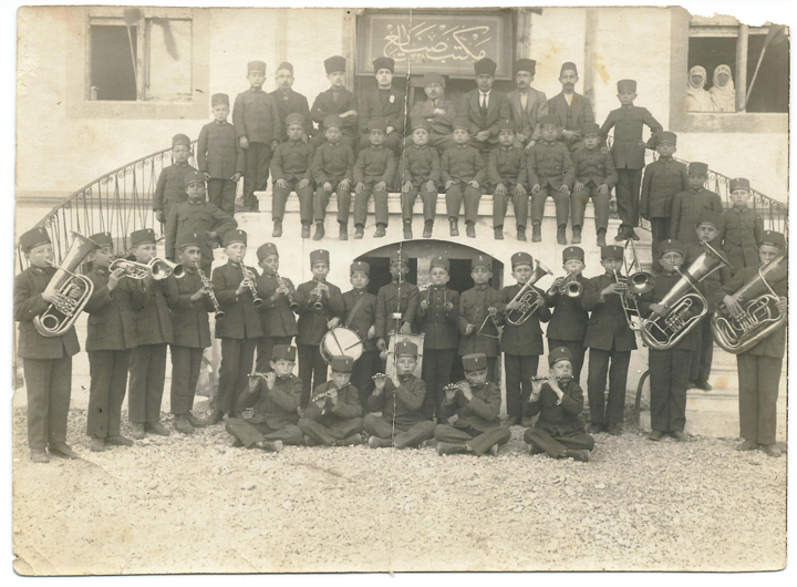 Izmir Sanayi Mektebi Bandosu - Emre ARACI Archive. The school band of the Islahhane (or Sanayi Mektebi) of Izmir, c. 1909–10. Reproduced by permission from the personal collection of Emre Aracı.