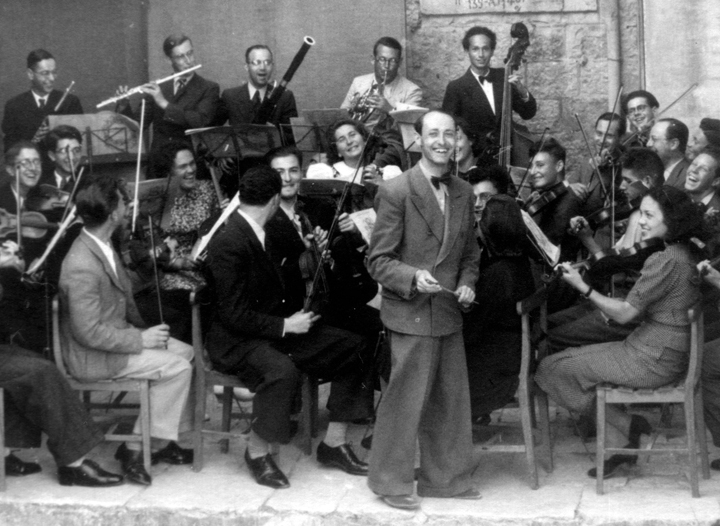 Josef Tal (center) with the Palestine Conservatoire of Music and Dramatic Art Orchestra, Jerusalem, 1939.