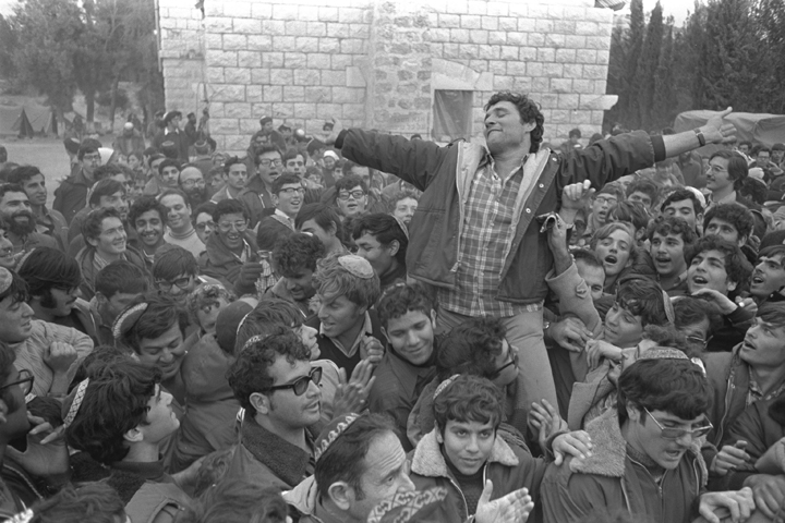 Gush Emunim leader Hanan Porat is carried on the shoulders of his followers as they celebrate the agreement which allows the settlers to stay in Samaria, August 12, 1975