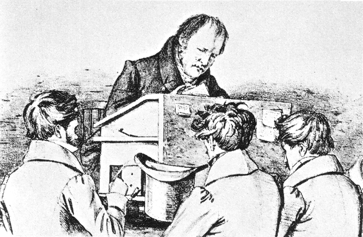 """Hegel am Katheder [Hegel teaching his pupils],"" lithograph, 1828 by F. Kluger. Schiller Nationalmuseum Marbach am Neckar; via Wikimedia Commons."