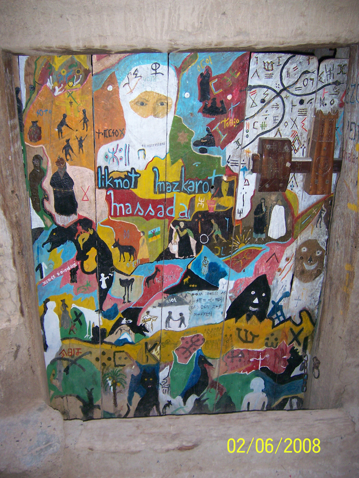 Painted door to an Amazigh activist artist's house in the old Jewish quarter; Goulmima, Morocco,  mid-2000s. Photo by author.